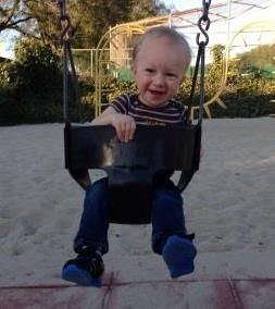 Infant in Swing - Playground - Caucasian - Male - Nathaniel Miller - Crop
