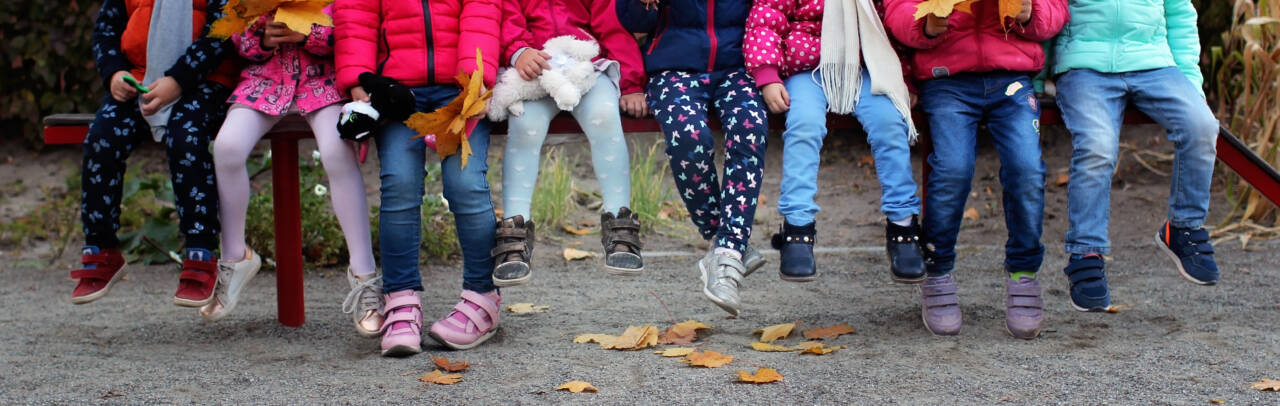 Group,Of,Diverse,Kids,Sitting,Together,On,The,Bench,In